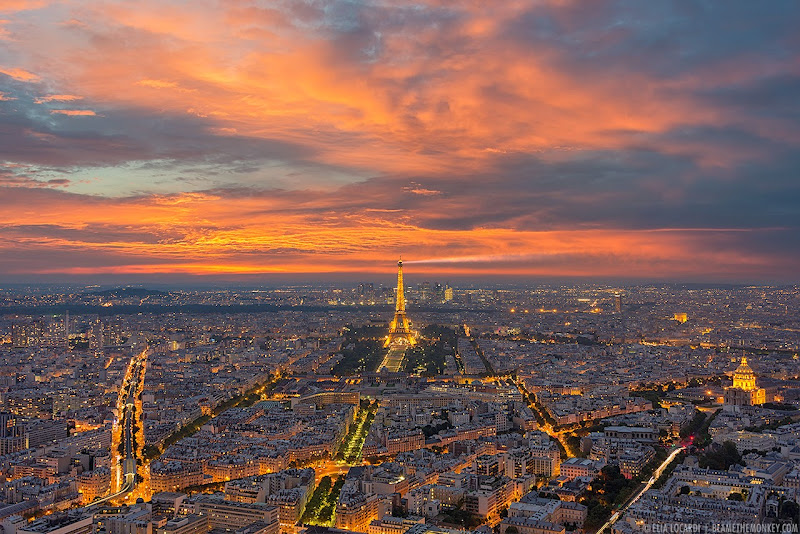 From the top of Montparnasse Tower, the sky above Paris France explodes with vivid color and light. Photographer Elia Locardi