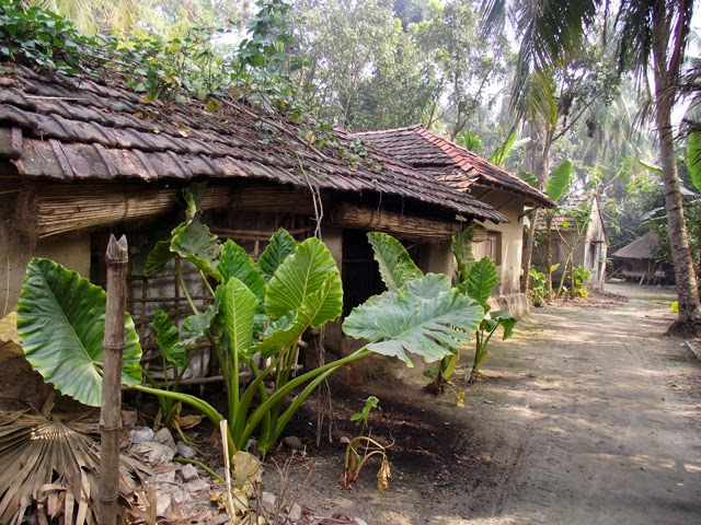 houses made of clay in Bangladesh village