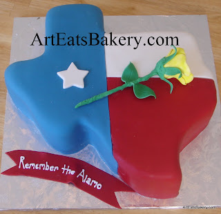 Red white and blue Texas state cut out cake with yellow edible rose and Remember the Alamo