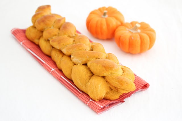 Double Braided Pumpkin Bread with two small pumpkins in the background