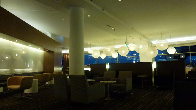 Inside the Qantas International Business Lounge, Sydney Airport, seating and lights