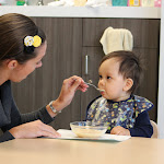 LePort Private School Irvine - Montessori infant teacher feeding baby