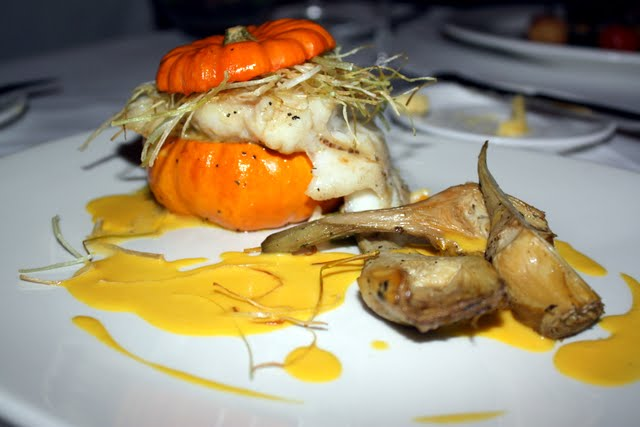 Halibut with risotto served in a pumpkin The Dining Room Restaurant at the Stoke Park Hotel in England