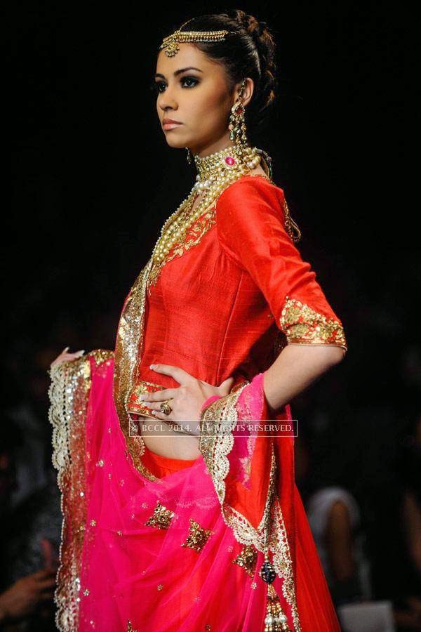 A model displays a creation by Golecha Jewels on Day 3 of India International Jewellery Week (IIJW), 2014, held at Grand Hyatt, in Mumbai.<br /> <br /> <br /> <br /> <br />