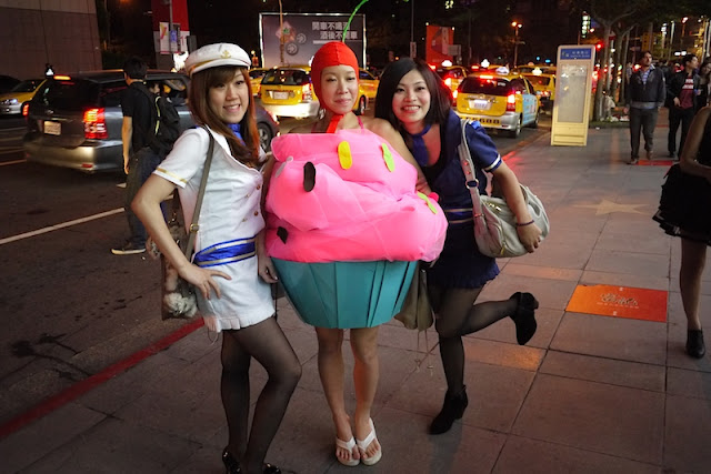 young women wearing cupcake and sailor costumes for Halloween in Taipei, Taiwan