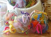Bird nesting materials: Coat hangers shaped into a ball hold yarn scraps
