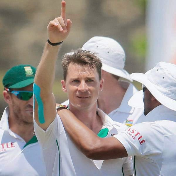 South African bowler Dale Steyn, center, gestures as he celebrates the dismissal of Sri Lankan batsman Lahiru Thirimanne, unseen, during the fifth day of the first test cricket match in Galle, Sri Lanka, Sunday, July 20, 2014