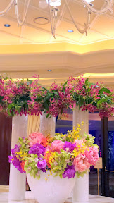 You can sort of see the glass doors leading to that terrace overlooking Lake of Dreams at the Wynn, Las Vegas, by the reception desks behind these flowers
