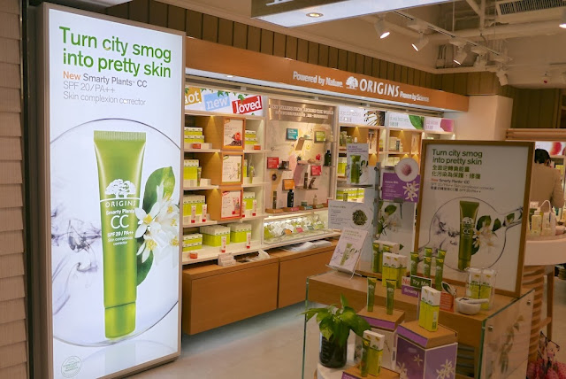 "Displays at an Origins store in Hong Kong stating ""Turn city smog into pretty skin"""