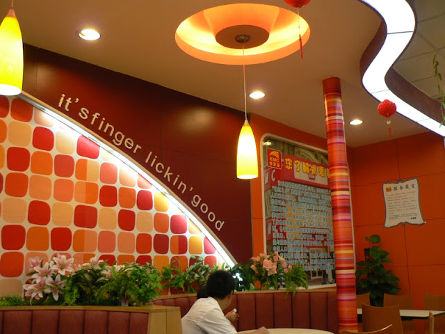 words saying it's finger lickin' good Inside of KMC restaurant in Chongzuo