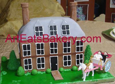 Coloinial Williamsburg fondant house with trees, shrubs and fondant figures in toy horse and buggy