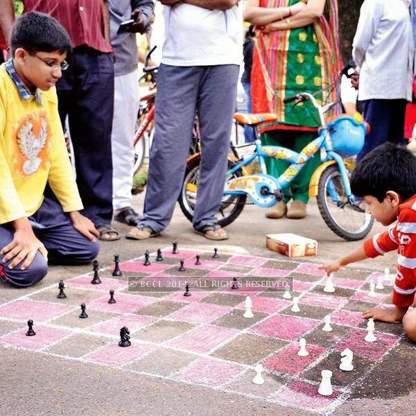 Children play chess during the Cycle Day celebrations, in Bangalore.