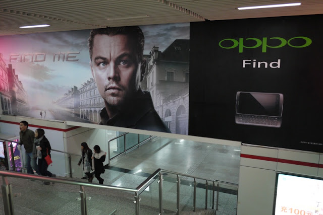 advertisement in Shanghai China with Leonardo DiCaprio for Oppo's Find Me campaign