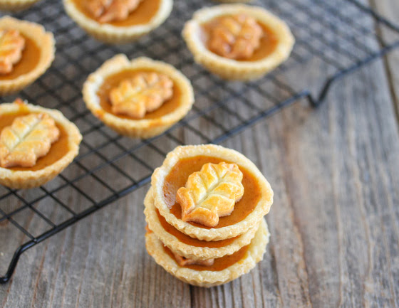 close-up photo of a stack of mini pumpkin pies