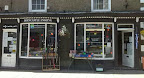 dark brown double shopfront of angling shop