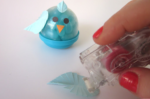 Use Martha Stewart's permanent adhesive roller to attach feathers, beak, and eyes.