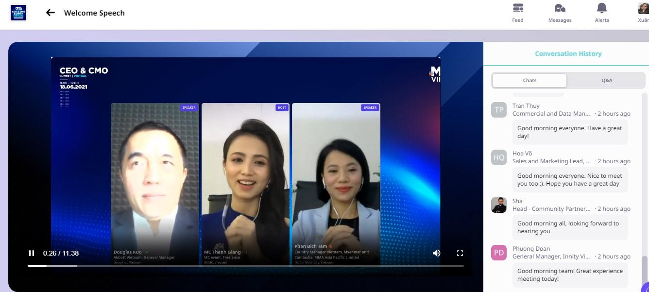 """May be an image of 3 people and text that says """"Welcome Speech CEO CMO 18.06.2021 Feed Messages Alerts SPEAKER VII Conversation History SPEAKER Chats Q&A Thuy Data Man... 2hours ago morning everyone. ave great 0:26/11:38 Marketing Lead,. Good 2hours ago everyone. ice Hope have great hanBichTam Head Community Partner.. 2hoursago looking forward Phuong 2hours ago today! experience"""""""