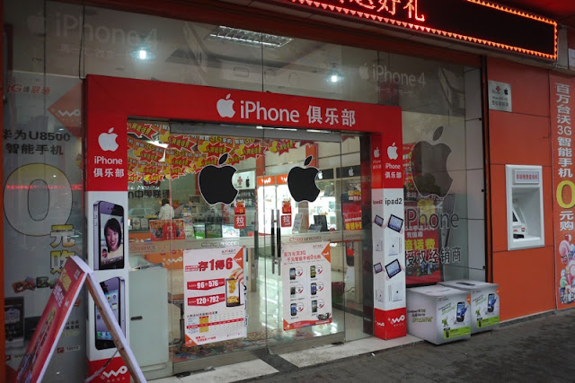 store in Chenzhou with prominent Apple logo and word iPhone on its sign