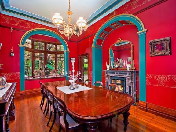 The rich red walls are a Victorian style, the arches Romanesque, not Gothic (gothic arches are pointed). The floorboards are a Federation feature.
