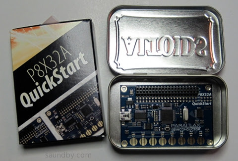 Parallax P8X32A Quickstart Board, shown inside an Altoids Tin for scale.