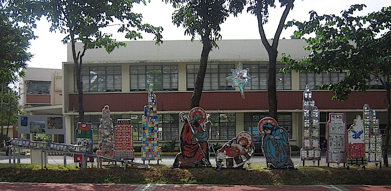 nativity scene made out of old computer parts, CDs and plastic tubing set in Manila with building and made of used foil snack bags