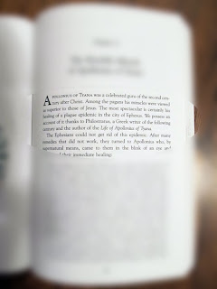 same page of text seen through glasses with the edges blurred