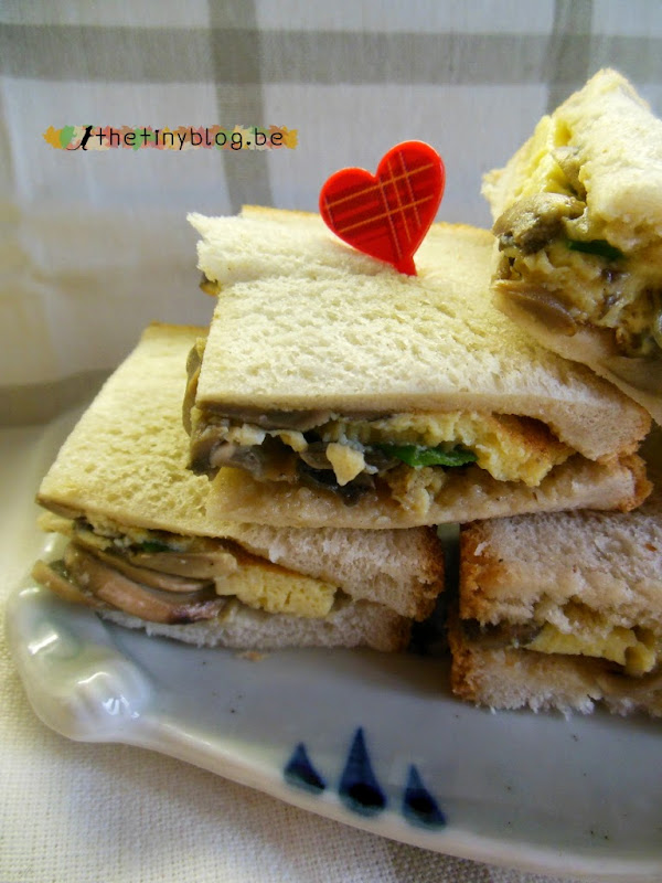 Omelette and mushrooms sandwich