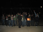A flock of fans watch the busses after the show