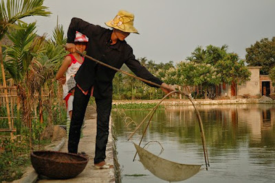 Catching shrimp in Yen Duc Village, more at http://www.reddragoncruise.com