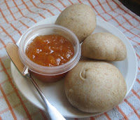 peach jam and honey-wheat rolls