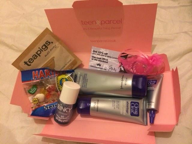 contents of a teen parcel box, haribo, nail varnish, tampons