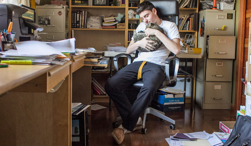 Black Karate Casual Pants: Holding Cat in Office