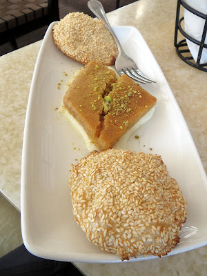 Baltimore Lebanese Taverna Knafe bel jibne a dish of sweet cheese tart, golden semolina crust and sesame seed biscuit