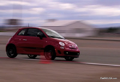 Red Fiat 500 Abarth at speed