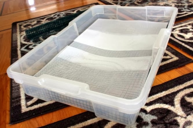 finished litter box with plastic mesh on top