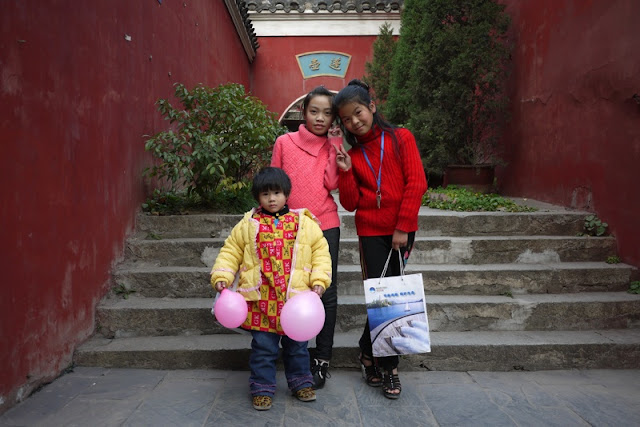three children at Chang Chun Temple in Wuhan