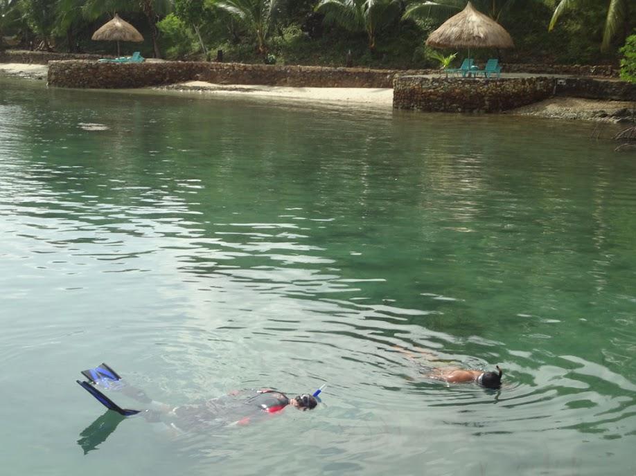 Nick (resort tour guide) and Tony looking for seahorses at Chindonan Island Resort, Palawan, Philippines.