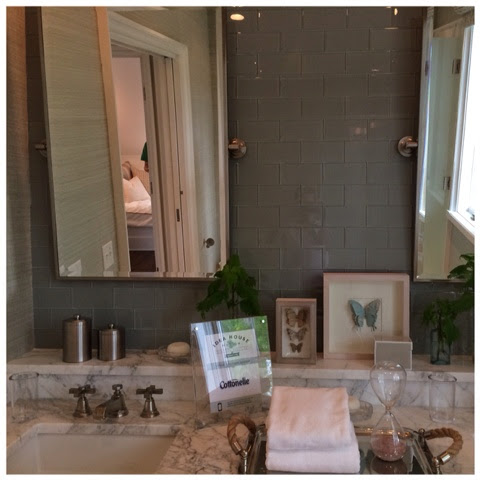 Shiny brown subway tile in guest bathroom.  2014 Southern Living Idea House in Palmetto Bluff, SC | The Lowcountry Lady