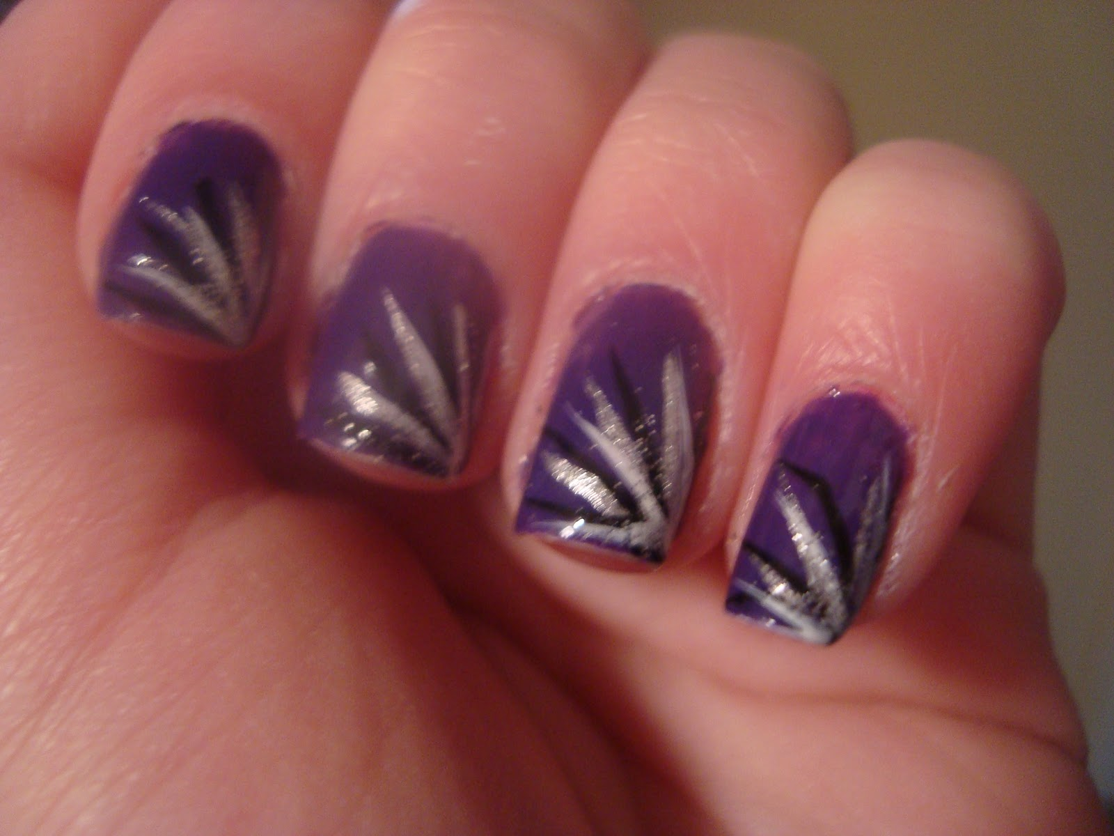 painted my nails with lines coming out from the corner of my nail