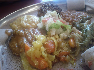 Blue Nile's Vegetarian Platter. Cabbage with carrots and onions, red lentils, spiced chickpeas, green beans, salad, the works.