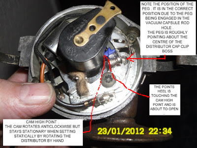 DISTRIBUTOR SHOWING POINTS ABOUT TO OPEN WITH THE PEG IN THE CORRECT PLACE AND ROTOR ARM POINTING AT NUMBER ONE CYLINDER