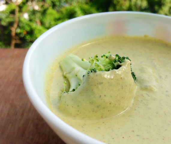 Broccoli dipped in Vegan Mango Sour Cream