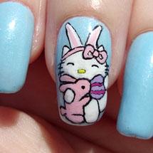 Unhas decoradas com Hello Kitty para a páscoa