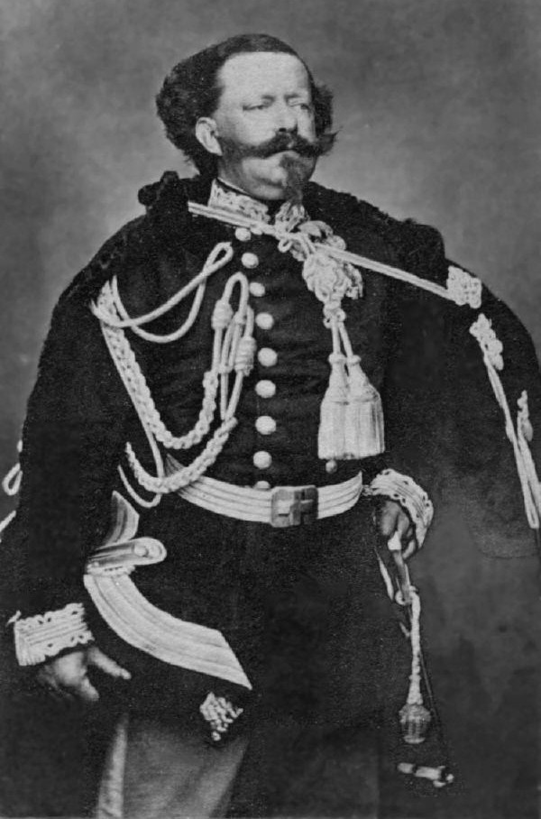 Photograph of Victor Emmanuel II.  His mustache extends horizontally beyond his cheeks.