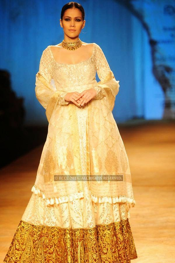 A model walks the ramp for Rimple and Harpreet on Day 6 of India Couture Week, 2014, held at Taj Palace hotel, New Delhi.<br />