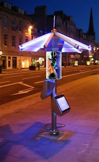 LED's illuminate the Umbrella Communications Hub in Union Street Outside the famous Music Hall, Aberdeen. Photograph shows test illuminated poster advert.