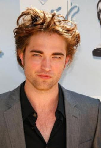 Robert Pattinson Claims He Still Single