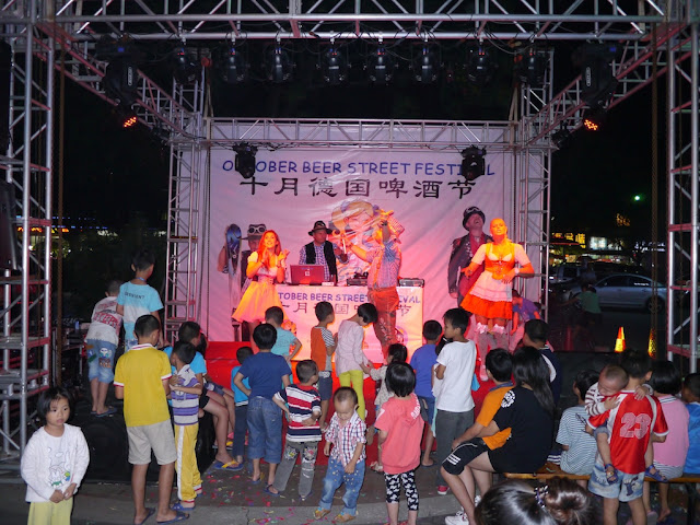 singers and dancers on the stage at Zhuhai's October Beer Street Festival