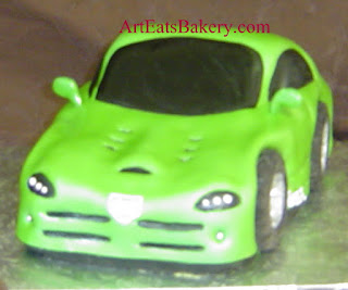 Unique green fondant sculpted Dodge Viper car Groom's cake design with chocolate tires