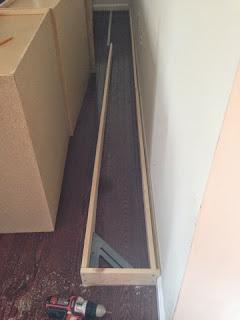 bottom of cabinet base on floor
